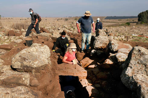 Israel Antiquities Authority (IAA) archeologists work at a fortified complex from the time of King David which was exposed for the first time in archaeological excavations carried out by IAA in the Hispin settlement in the Israeli-annexed Golan Heights