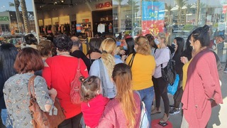 A crowd of people wait to get inside the FOX store in BIG Be'er Sheva