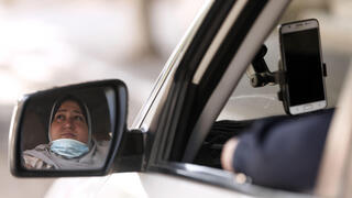 The first female Palestinian taxi driver in the Gaza Strip, Nayla Abu Jubbah