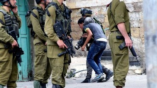 A Palestinian minor arrested by IDF forces