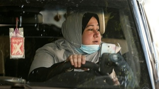The first female Palestinian taxi driver in the Gaza Strip, Nayla Abu Jubbah,