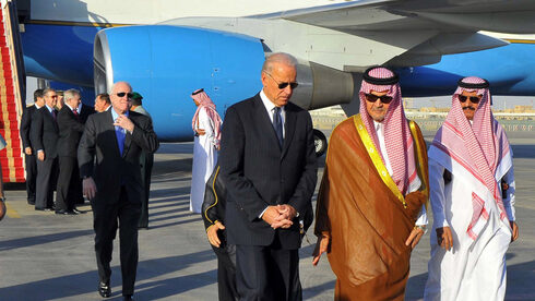 Then-Saudi foreign minister Prince Saud al-Faisal (second right) welcomes then-U.S. vice president Joe Biden to Riyadh, October 2011