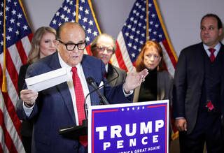 Former U.S. President Donald Trump's lawyer Rudy Giuliani in a November press conference claiming voter fraud