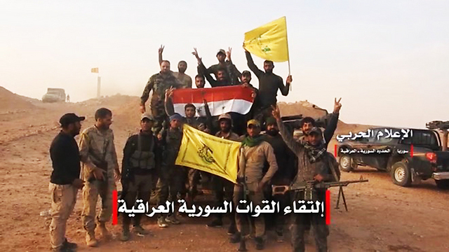 Iranian-backed militias in Syria waving the Hezbollah and Syrian flags