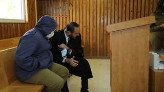 Rom Abergil in court with his lawyer