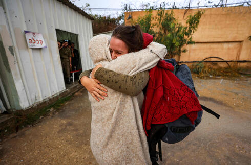 "Hallel Rabin (behind), a 19-year-old Israeli conscientious objector, embraces her mother Irit Rabin outside the ""number six"" military prison near Atlit in northern Israel"