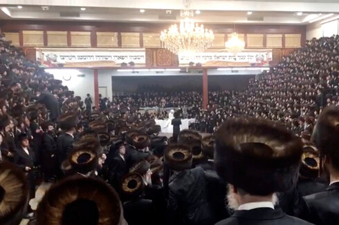 Guests squeezed inside the Yetev Lev temple in Williamsburg for the wedding of a chief rabbi's grandson