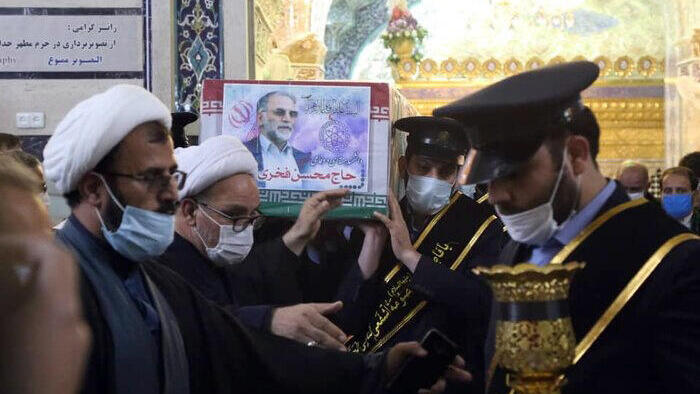 the coffin of Iranian nuclear scientist Mohsen Fakhrizadeh carried inside the Shrine of Masoumeh, during a funeral ceremony in the city of Qom
