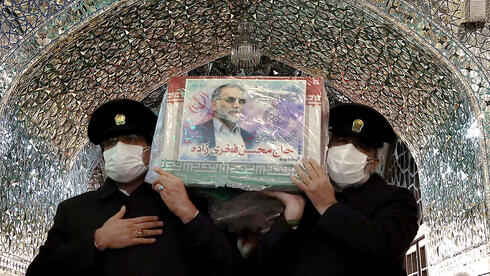 Servants of the holy shrine of Imam Reza carry the coffin of Iranian nuclear scientist Mohsen Fakhrizadeh, in Mashhad, Iran