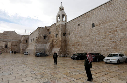 A Palestinian man poses for a picture outside the Church of the Nativity, amid the coronavirus disease (COVID-19) outbreak, in Bethlehem in the Israeli-occupied West Bank