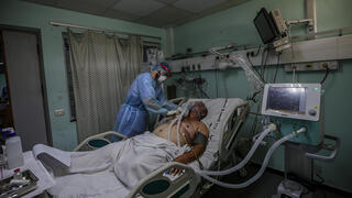 Treating a coronavirus patient in the Gaza Strip