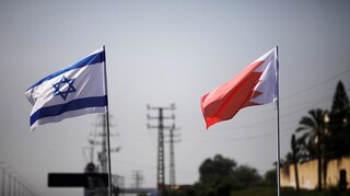 The flags of Israel and Bahrain flutter along a road in Netanya