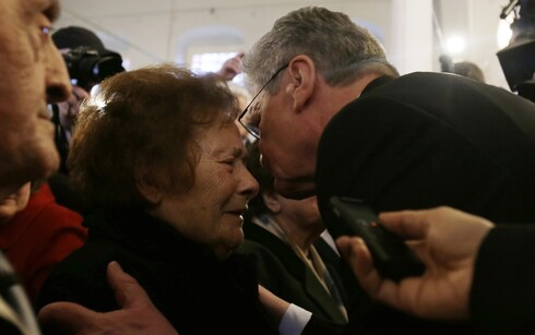 German President Joachim Gauck, right, kisses 93-year-old Esther Cohen,, a Greek Jewish death camp survivor, during his visit at a synagoge in Ioannina, northwestern Greece, on March 7, 2014