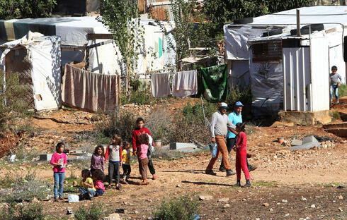Syrian refugees are pictured at a refugee camp in Marjayoun, southern Lebanon