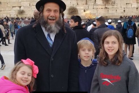 David Walk with his children at the Western Wall in Jerusalem