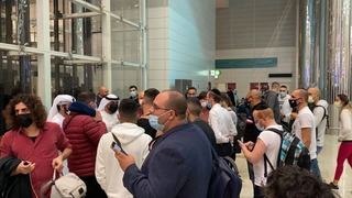 Israelis wait at Dubai airport after they were denied entry due to a lack of a visa