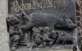 """The so-called """"Judensau,"""" or """"Jew pig,"""" sculpture is displayed on the facade of the Stadtkirche (Town Church) in Wittenberg, Germany"""