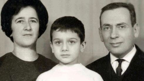 Elie Abadie with his parents in a travel document photo, 1968
