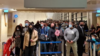 Travelers waiting in line at Ben Gurion Airport