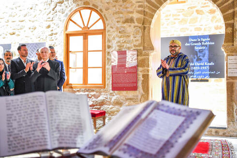 """Morocco's King Mohammed VI (R) during a visit to the """"Bayt Dakira"""" (House of Memory) museum, in the Atlantic coastal city of Essaouira"""