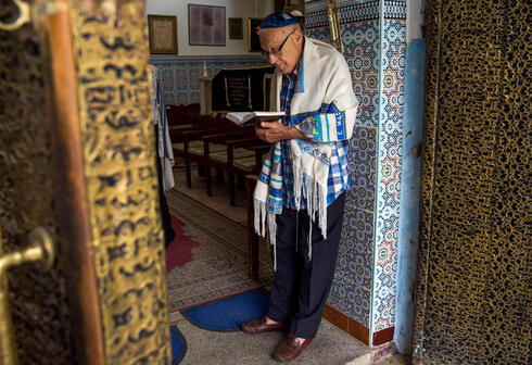 Moroccan Jews and Israeli Jewish tourists participate in a religious ceremony to observe the holiday of Sukkot at a synagogue in in Marrakesh