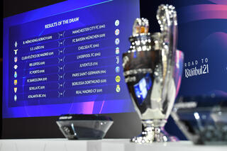 UEFA Champions League cup presented at the 2021 edition's last 16 draw