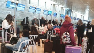 Israelis check in at Ben-Gurion Airport for a flight to Dubai before the skies were closed due to the pandemic