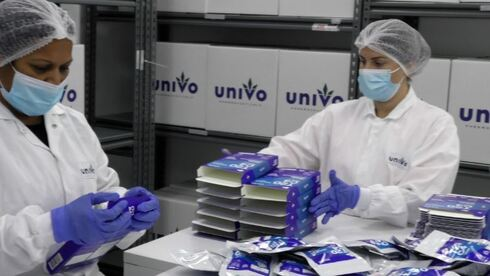 Workers at Univo package medical products
