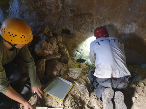 Recording measurements of the ancient cistern from the Hasmonaean period