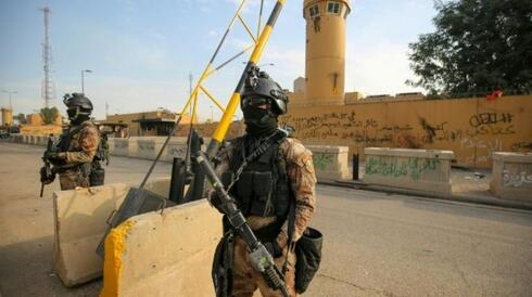 An Iraqi security guard near the US embassy in the Green Zone