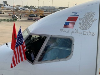 A plane bearing the Israeli and Moroccan flags prepares to take off from Tel Aviv to Rabat, December 2020