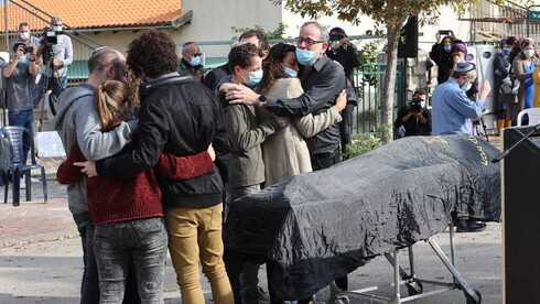 The family of murdered Eshter Horgan embraces as her funeral begins