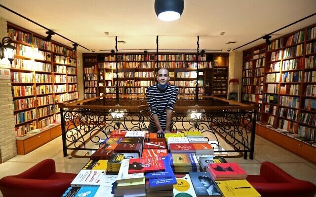 An Iranian employee poses for a picture at a bookstore in Tehran's Enqelab (Revolution) street