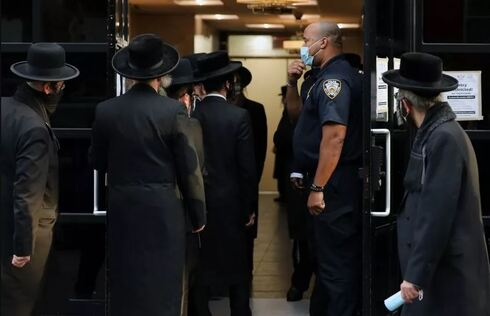People gather outside of the Congregation Yetev Lev D'Satmar synagogue in the Williamsburg neighborhood in the Brooklyn borough of New York City, October 2020