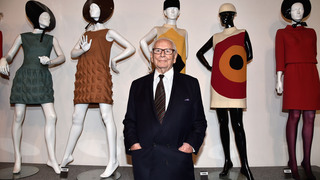 Pierre Cardin with his designs