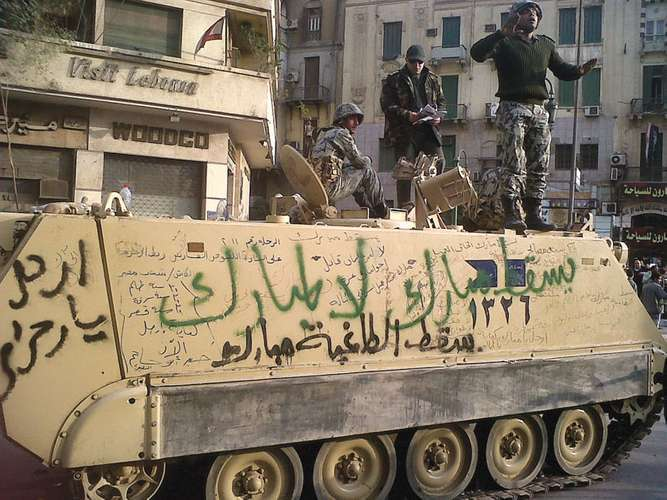 AP_Egyptian personnelcarrier with Anti Mubarak graffiti in Cairo in 2011
