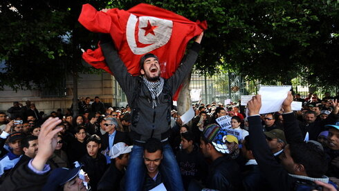 Demonstrators outside the French embassy in Tunis after a fruit vendor set himself on fire in 2011