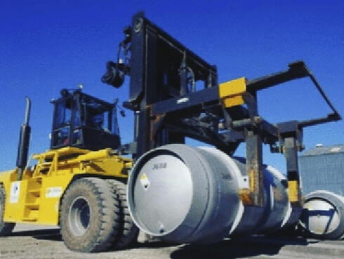a forklift carries a cylinder containing uranium hexafluoride gas for the purpose of injecting the gas into centrifuges in Iran's Fordo nuclear facility