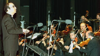 Lebanese maestro Elias Rahbani conducts his orchestra during a concert at the Casino du Liban