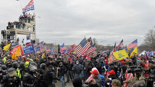 A pro-Trump mob clashes with police on Wednesday outside the U.S. Capitol