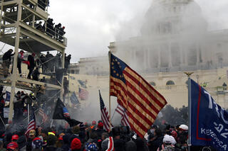 Trump supporters confront security while attempting to break into the U.S. Capitol