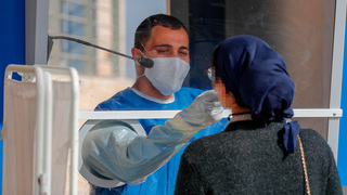 Testing for coronavirus in Jerusalem last month