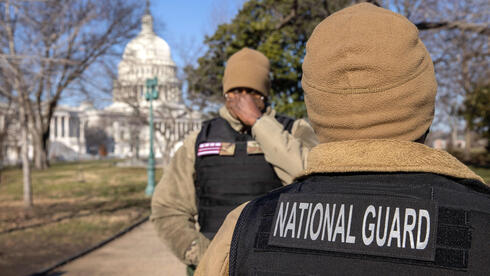 National Guard guardsmen stand outside the U.S. Capitol