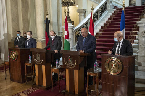 From left to right, German Foreign Minister Heiko Maas, Jordanian Foreign Minister Ayman Safadi, Egyptian Foreign Minister Sameh Shoukry, and French Foreign Minister Jean-Yves Le Drian, hold a press conference at Tahrir Palace, in Cairo, Egypt