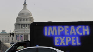 A demonstrator sits in a truck with a video screen near the U.S. Capitol in Washington,
