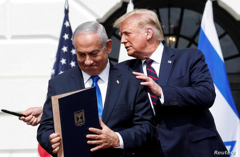 Prime Minister Benjamin Netanyahu stands with US President Donald Trump after signing the Abraham Accords, at the White House