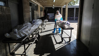 Victims of COVID-19 being prepared for burial  at Holon cemetery in central Israel, Jan. 2021