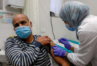 A Palestinian from East Jerusalem being vaccinated for coronavirus
