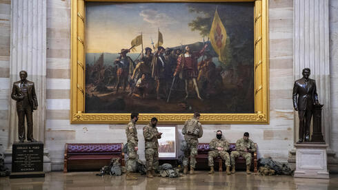 Newly deployed National Guard troops rest in the Capitol Rotunda,  Jan. 13 2021