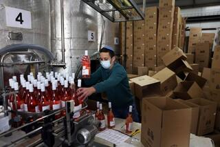 An employee sorts wine bottles as he works at Tura Winery in Rehelim, an Israeli settlement in the West Bank